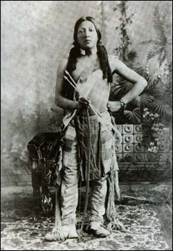 An Apache brave posing with arrows
