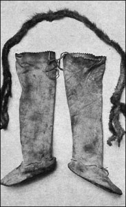 These plain undercoated combination leggings and moccasins were used by the Shoshone Indians. A mink belt is also shown.